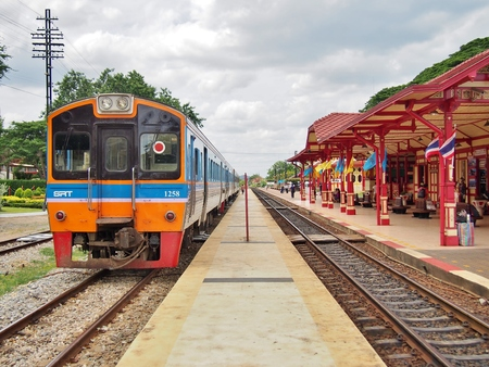 diesel train: HUA HIN, THAILAND - AUGUST 29: Diesel train is coming to platform at the Hua Hin train station, one of the oldest train stations in Thailand on August 29, 2014.