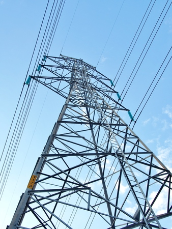 conduction: electric high voltage power post with blue sky Stock Photo