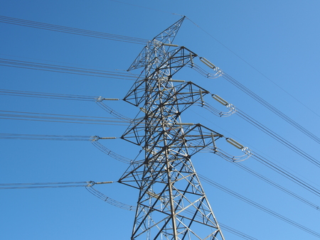 conduction: electric high voltage power post with blue sky.