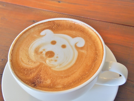 cute dogs: Latte Coffee art Dog Face on the wooden desk.