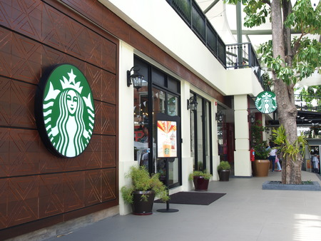 BANGKOK, THAILAND - AUGUST 22, 2015: Starbucks coffee shop at Tha Maharaj on the bank of the Chao Phraya river in Bangkok, Thailand. Starbucks is the worlds largest coffee house. Editorial