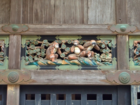 A carving of Three wise monkey, detail of the seventeenth century Toshogu shrine in Nikko, Japan. Together they embody the proverbial principle: see no evil, hear no evil, speak no evil.