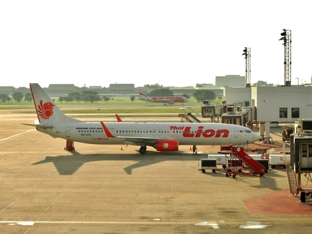 on air: BANGKOK, THAILAND - OCTOBER 15, 2015: Boeing 737-900 Thai Lion Air parked at Don Mueang International Airport in Bangkok, Thailand. Thai Lion Airways is the new low cost airline in Thailand. Editorial