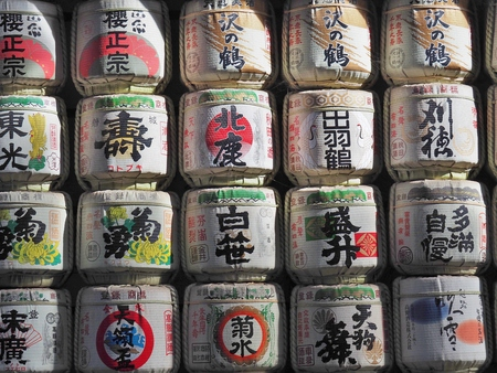 temple tank: TOKYO, JAPAN - NOVEMBER 15, 2015: Barrels of sake nihonshu donated to the Meiji Shrine in Tokyo, Japan. Japanese donate sake to the temples and shrines as offering for the Gods.