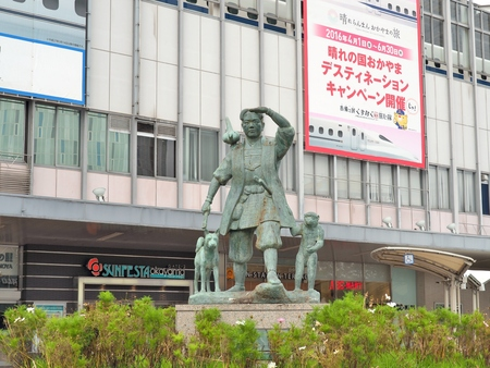 OKAYAMA, JAPAN - NOVEMBER 20, 2015: The statue of Momotaro and his friends - monkey, dog and pheasant in front of Okayama railway station. Momotaro is a popular hero of Japanese folklore originated from Okayama Prefecture, Japan. His name literally means
