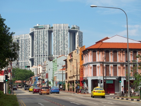 SINGAPORE - MAY 9, 2015: The junction of South Bridge Road with Upper Cross Street in Singapores Chinatown. The big white buildings are actually public housing buildings called The PinnacleDuxton. Editöryel