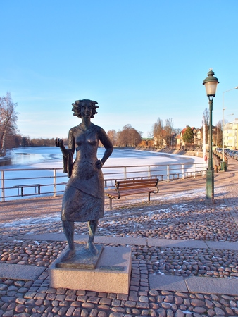 karlstad: KARLSTAD, SWEDEN - FEBRUARY 25, 2016: Statue of Eva Lisa Holtzat, a Swedish waitress and innkeeper who became the symbol for the Karlstad city. She was known in Sola i Karlstad (the Sun in Karlstad).