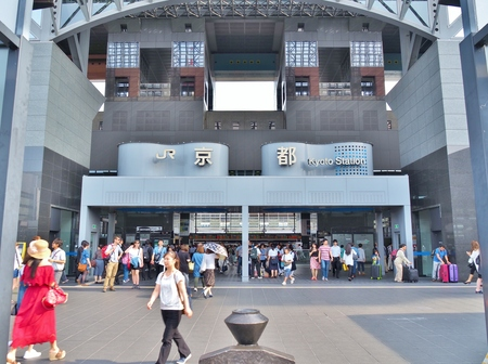 main gate: KYOTO, JAPAN - JUNE 8, 2016: Unidentified people walk around in front of main Central Gate of Kyoto Station in Kyoto, Japan. Kyoto Station is a Japans second-largest station building. Editorial