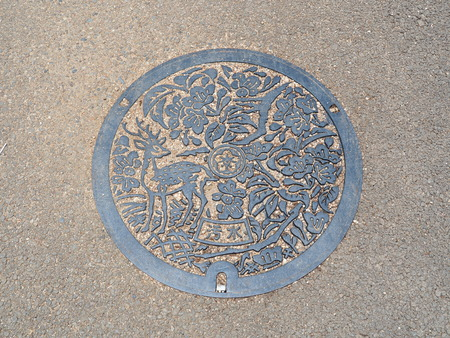 manhole cover: NARA, JAPAN - JUNE 06, 2016: The deer was engraved on manhole cover of Nara City in Nara, Japan.