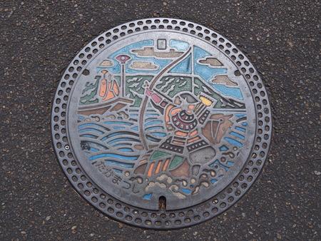 bushido: KAGAWA, JAPAN - JULY 22, 2016: A manhole cover in Takamatsu, Kagawa, Japan. Nasu no Yoichi, who particularly famous for his actions at the Battle of Yashima in 1184 was engraved on a manhole cover. Editorial