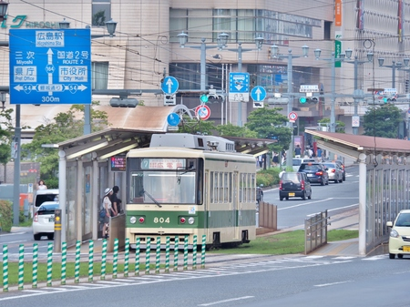 atomic bomb: Hiroshima, Japan - July 18, 2016:  The streetcar Hiroden parked at station near Atomic Bomb Dome in Hiroshima, Japan. Streetcar is useful and cheap transportation in Hiroshima-city. Editorial