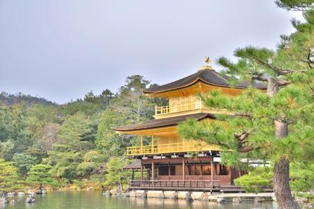 rokuonji: Kinkaku-ji Temple with Japanese garden in Kyoto, Japan. The Golden Pavilion (Kinkaku) is a three-story building on the grounds of the Rokuon-ji temple complex.