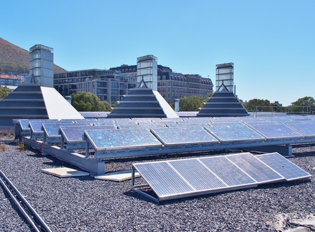 Solar panels or Polycrystalline Silicon Solar cells on rooftop or terrace of building in Cape Town, South Africa. Green or Sun or renewable or Clean energy. Saving energy, Zero Emission concept. Stok Fotoğraf