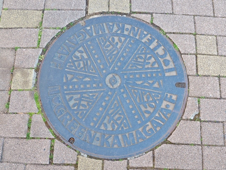 Chiba, Japan - February 26, 2017: Manhole cover of Kamagaya city in Chiba prefecture, Japan. Kamagaya city declare to non-nuclear peaceful city, so they engrave Green and Clean on their manhole cover. Stok Fotoğraf