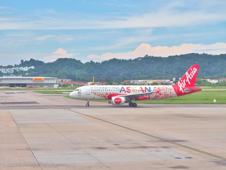Penang, Malaysia - May 13, 2017: An AirAsia Airbus preparing for take-off from Penang International airport in Penang Island, Malaysia. Air Asia is a low-cost airline from Malaysia. Editöryel