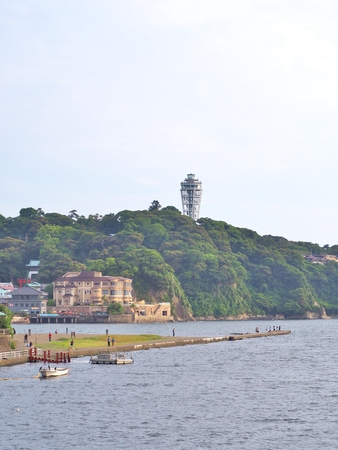 Enoshima, Japan - June 09, 2017: View of Enoshima island with sea in Kanagawa, Japan. Enoshima is a pleasantly touristy island just off coast but connected by bridge with the mainland.