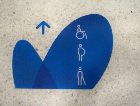 sign painted on the floor of the place where they must stand in line, the disabled and pregnant women