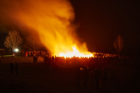 bright and warm Easter fire around which people gather Banco de Imagens