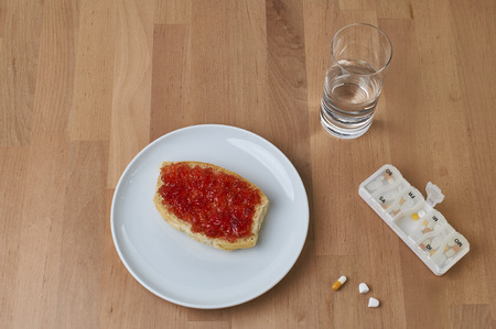 Take medication at breakfast with a sip of water