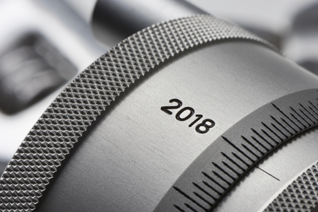 new year in the industry - The year 2018 is on a knurled setting wheel with scale