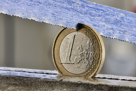 One euro coin is sawn - split Europe