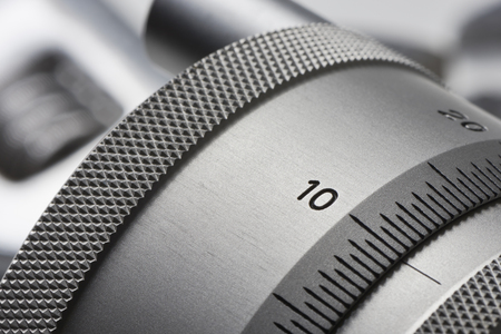 Setting wheel from a precision machine with a scale. On the Setting wheel is the number ten (10) Stok Fotoğraf