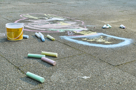 Drawing painted by a child with chalk on the asphalt