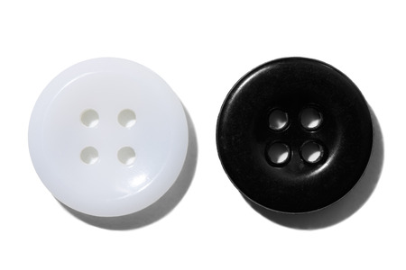 Difference - Two different buttons side by side in front of white background Stok Fotoğraf