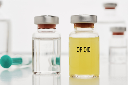 An ampoule with opioid. In the background there are still ampoules