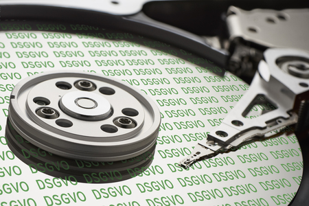 DSGVO hard disk - General Data Protection Regulation - on the disk disk is written several times DSGVO in green letters Stok Fotoğraf
