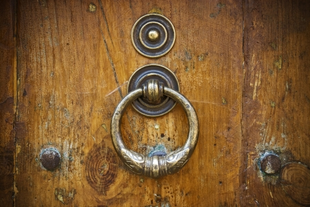 Metal knocker on old wooden door photo
