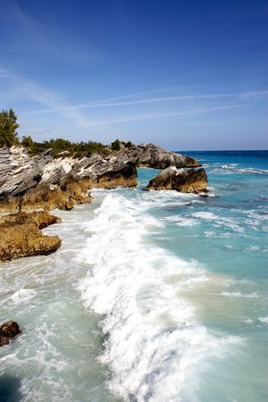 a tropical coast line with large crashing waves Stock Photo