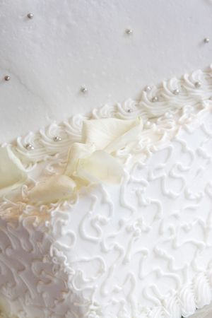 a white wedding cake close-up with neat little swirl details and silver candy buttons Stock Photo - 607943