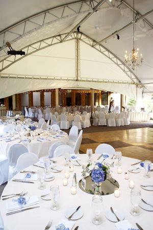 a typical wedding under a tent with tables set for eating dinner Stock Photo - 607938