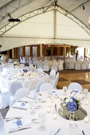 table linen: a typical wedding under a tent with tables set for eating dinner