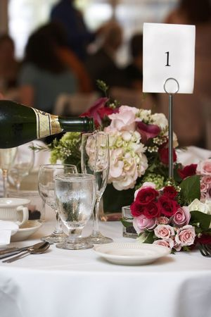 champagne being poured into fluted glasses during a wedding or social event Stock Photo