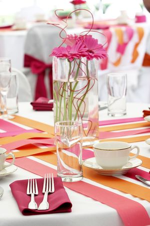 very cool and hip wedding table settings for a funky fresh young bride and groom. This is not your mama's wedding! Shallow depth of field with the focus on the fork and glass. One of several in this series. Stock Photo - 615087