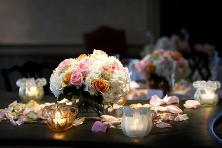 organizer: A bouquet of flowers with candles taken during a wedding event