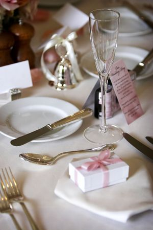 table setting for a wedding or dinner event, very shallow depth of field with the focus on the glass, blank name card in the background Stock Photo - 624845