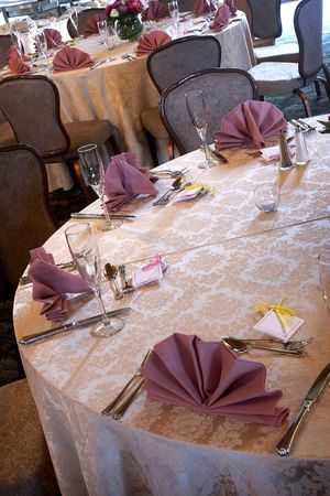 campagne: wedding tables set for fine dining during an event with blank name cards