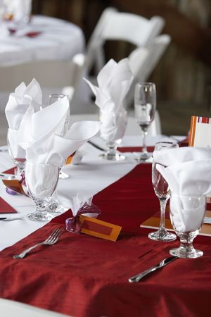 clothe: Wedding table set for fine dining with red table clothe and blank name cards Stock Photo
