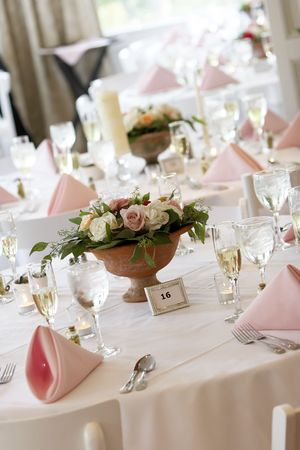 tables set for fine dining during a wedding event.