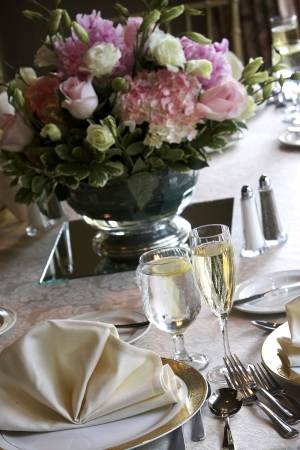 tables set for fine dining during a wedding event. Shallow depth of field, focus on items on the bottom of the table
