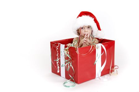 induced: A young child sitting in a christmas box staring at the camera in a candy induced coma! Stock Photo