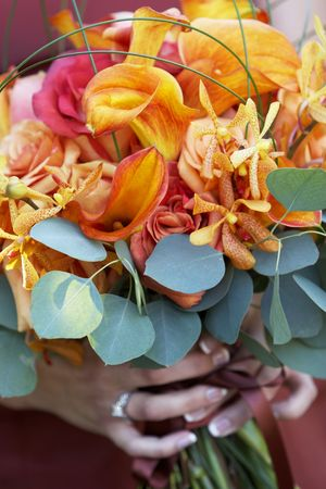Bridal wedding bouquet of flowers being held - detail Stock Photo - 665513