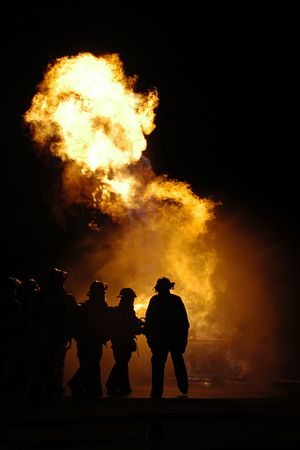 A group of fire fighters battle a large fire