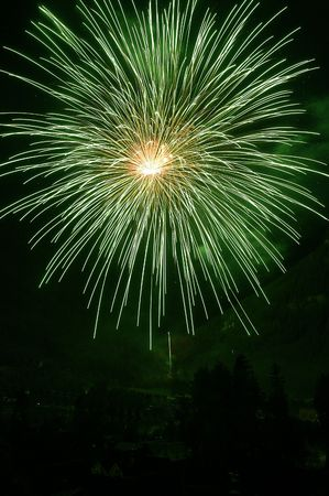 green smoke: green fireworks exploding on a field of black Stock Photo