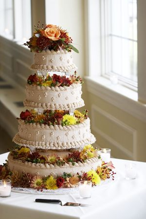 Wedding cake on a table with candles