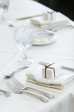 cater: details of a wedding table set for fine dining, gift box for the guest Stock Photo