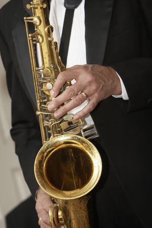 playing a brass horn - musical instrument